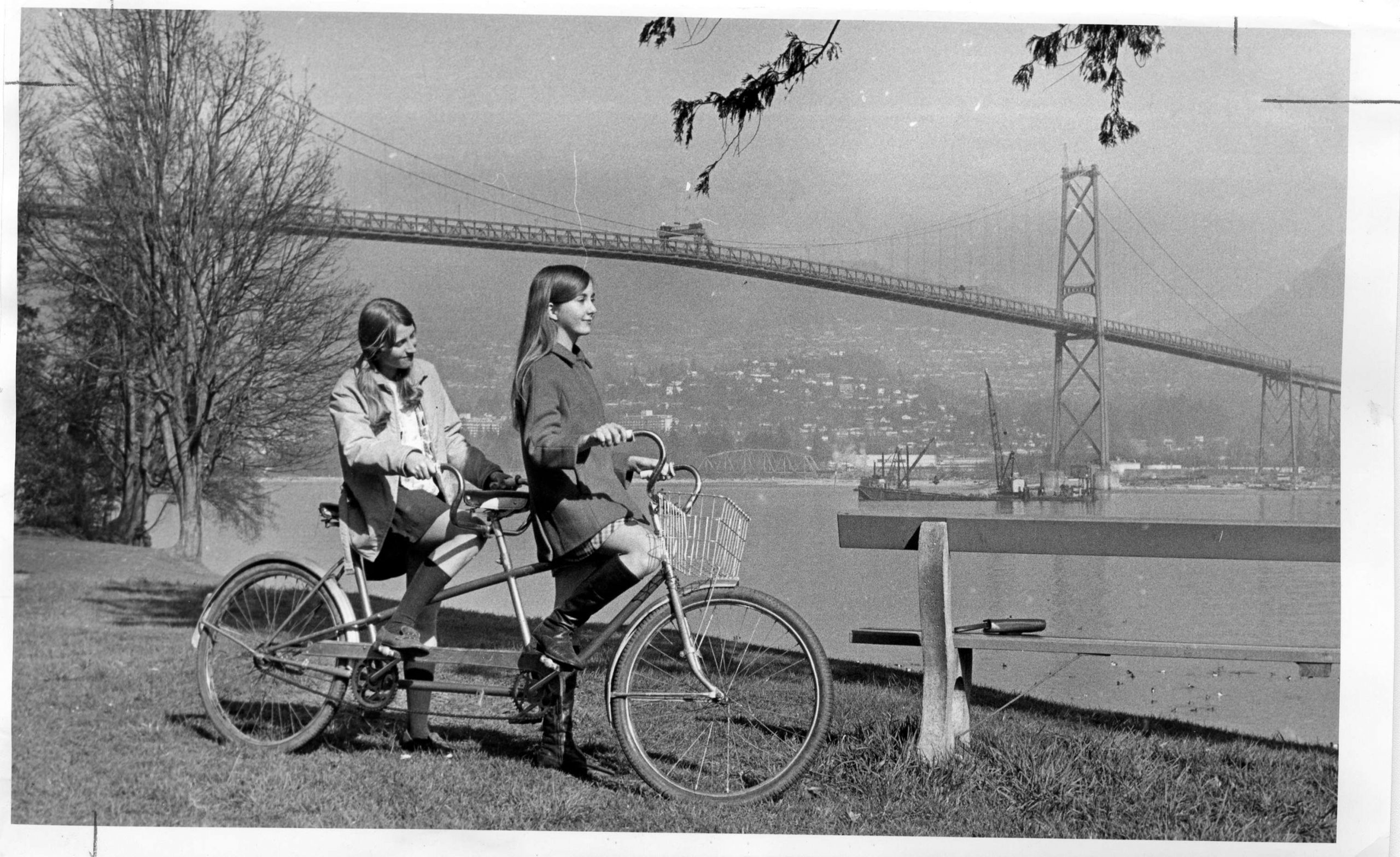 Pausing on a tandem bicycle in Stanley Park. Reference code: AM1667-: CVA 134-047