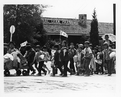 A photographic print taken by SPOTA showing a group of kids crossing the street at MacLean Park. Reference code: AM734-S4, 175-A-02 fld 05