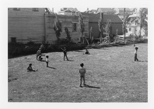 A photographic print taken by SPOTA showing children playing baseball in Strathcona. Reference code: AM734-S4