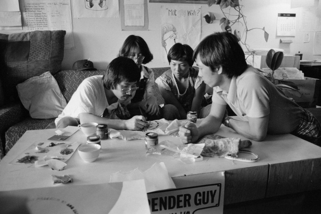 Jim Wong-Chu leading a silk-screening session for Pender Guy, 1977. Reference code: AM1523-S6-F13-: 2008-010.1052