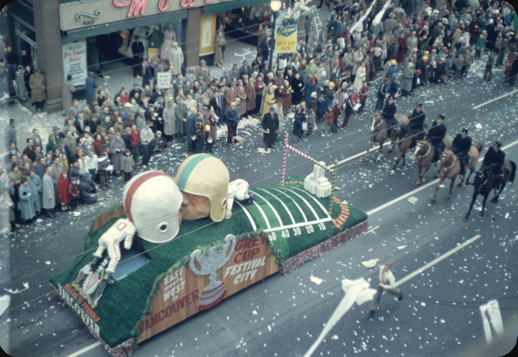 43rd Grey Cup Parade, on Granville Street, Welcome to Friendly Vancouver Grey Cup float, police on horseback and spectators; Reference code: AM1517-S1-: 2008-022.290.