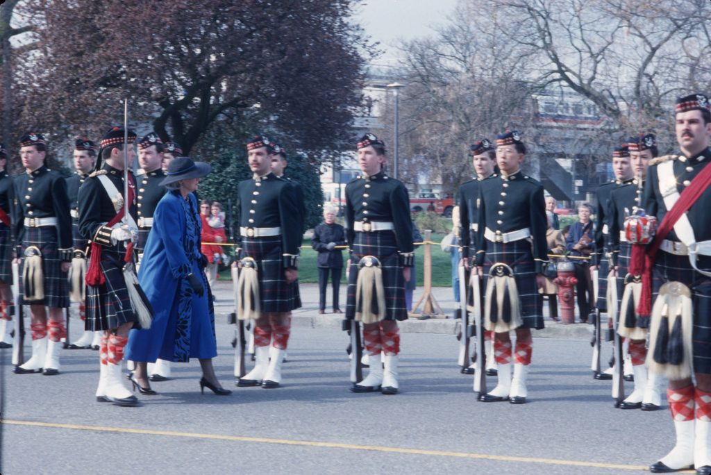 Governor General Jeanne Sauvé reviewing the Guard of Honour by the Seaforth Regiment of Canada at Canadian Pacific Station. Reference code AM1576-S6-12-F65-: 2011-010.705