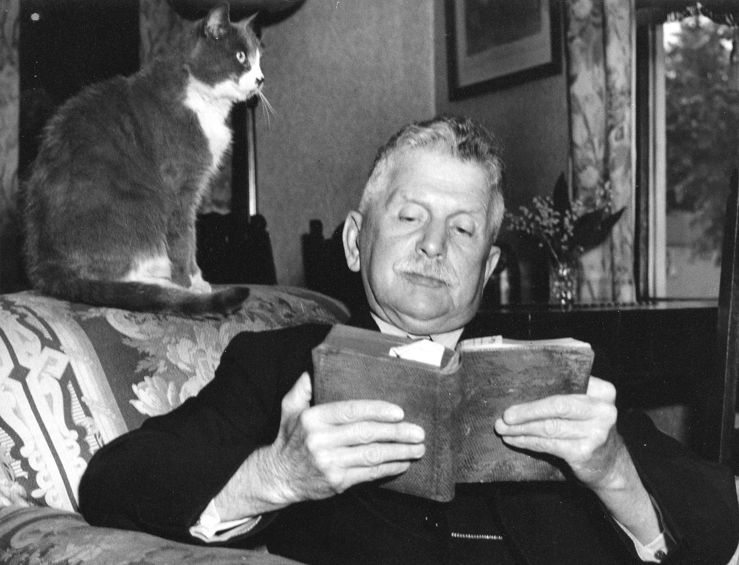 John Bennett with his cat, 1947. Reference code AM54-S4-: Port P1812.3