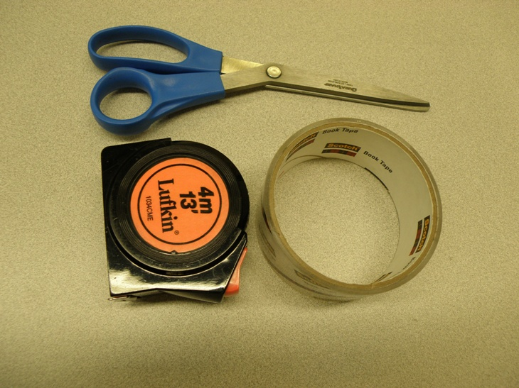 A tape measure to ensure an accurate physical description of books, and scissors and book tape for the labeling process.