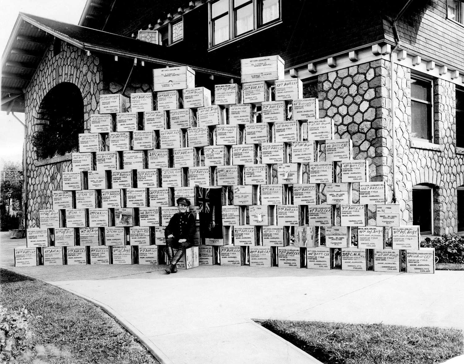 soldier in front of piled boxes