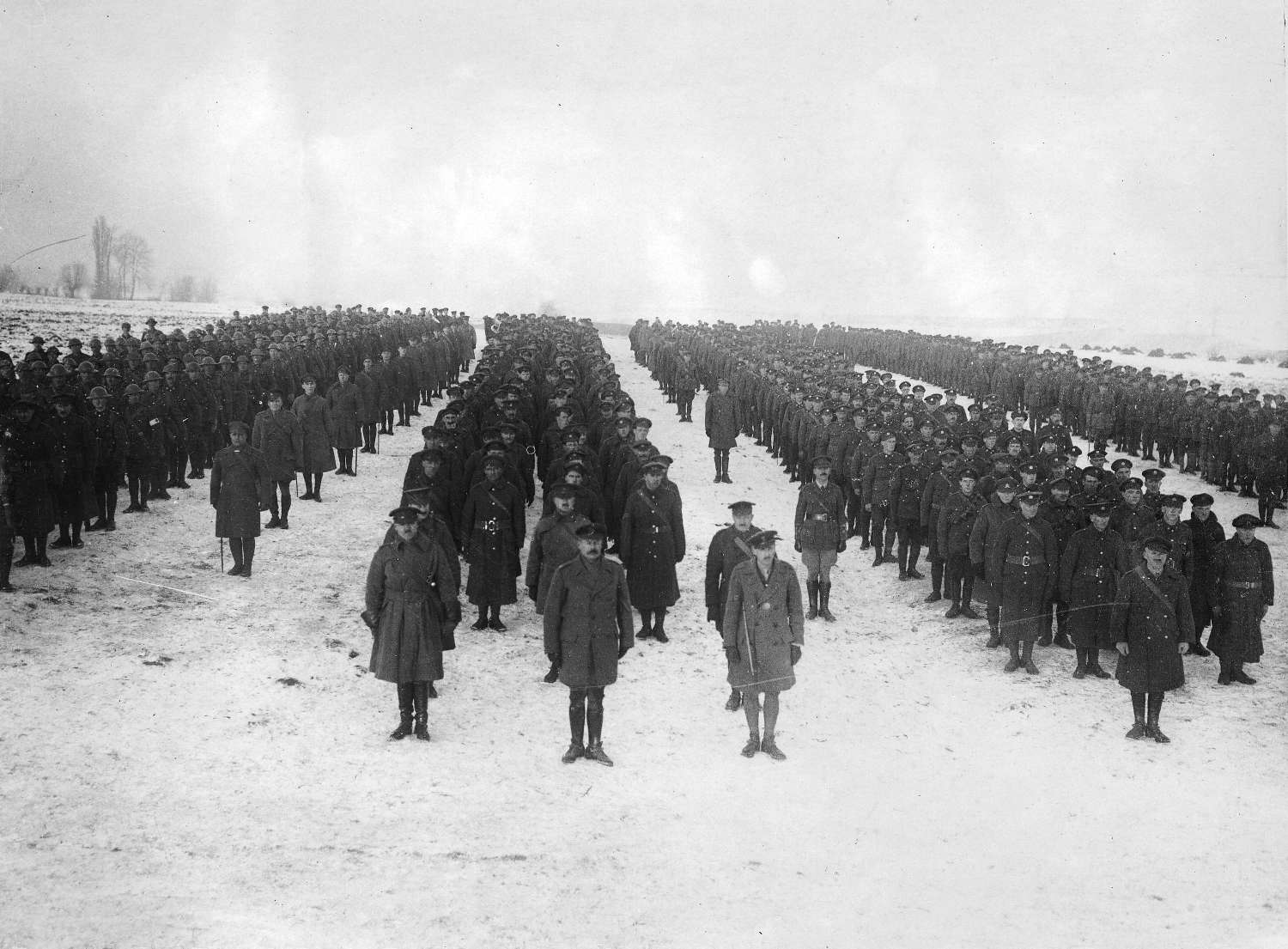 Canadian soldiers on parade at the Western Front, 1916. Official Photograph issued on behalf of the Press Bureau. Reference code AM54-S4-: Mil P281.50.