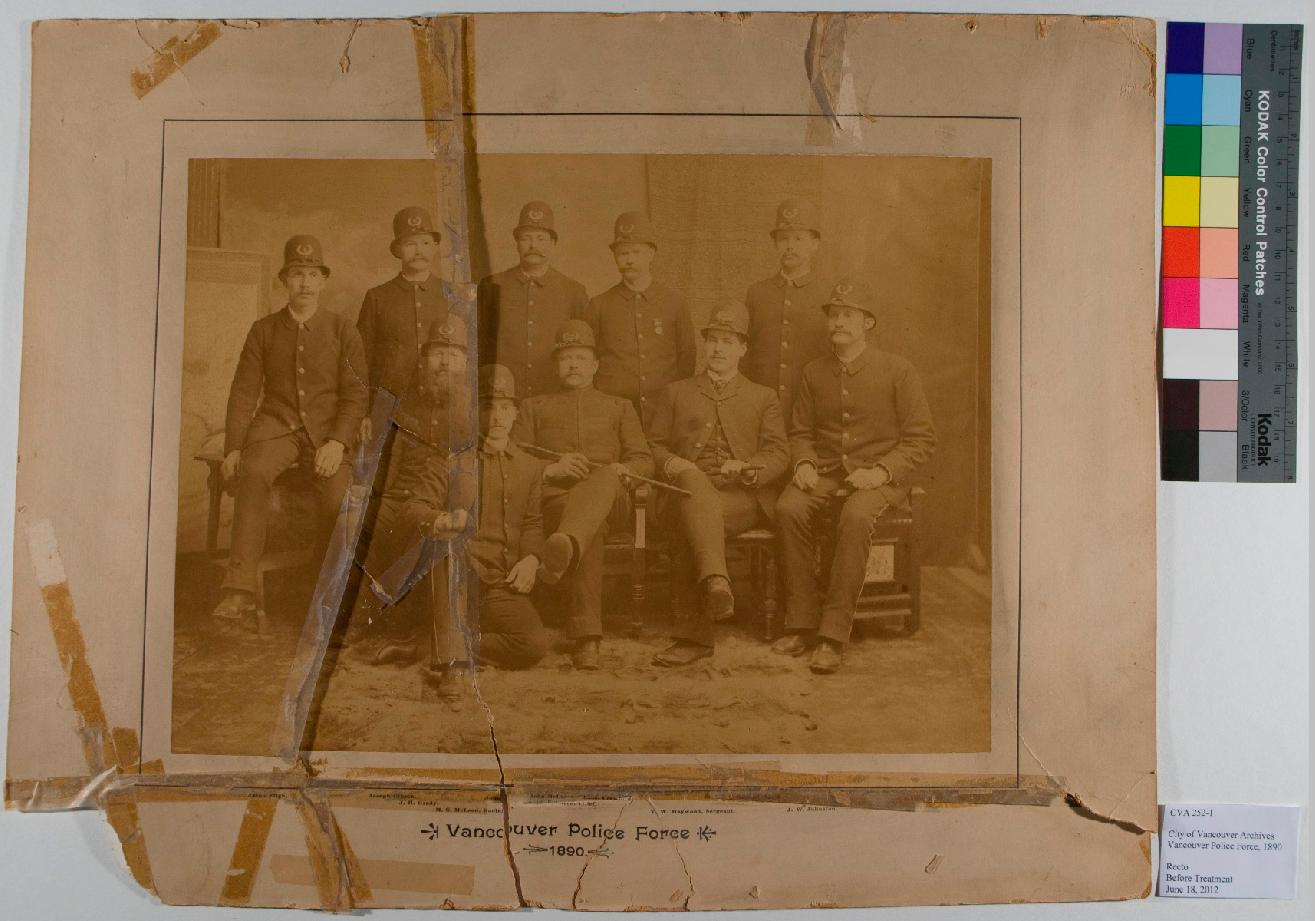 The albumen print of the 1890 Vancouver Police before treatment.