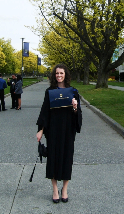 Kaitlin at UBC holding her B.A.