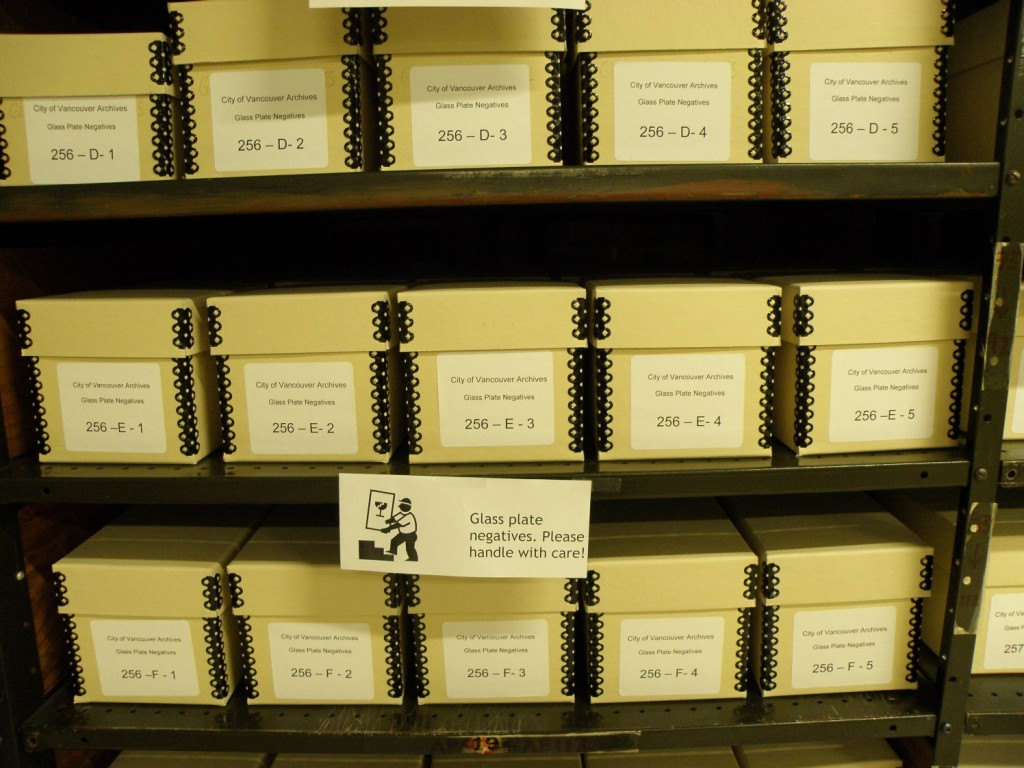 Boxes of glass plate negatives stored neatly on shelves.