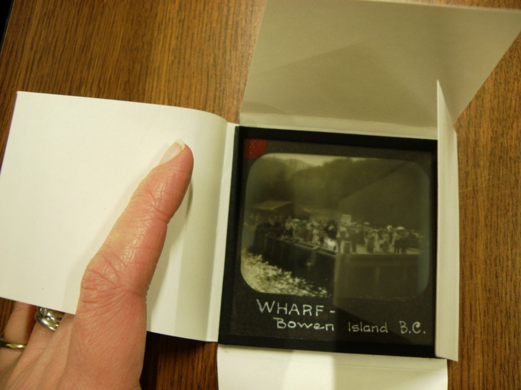 Cute little glass plate negative that is too small to properly store in the standard boxes. Photograph by Cindy Mclellan.