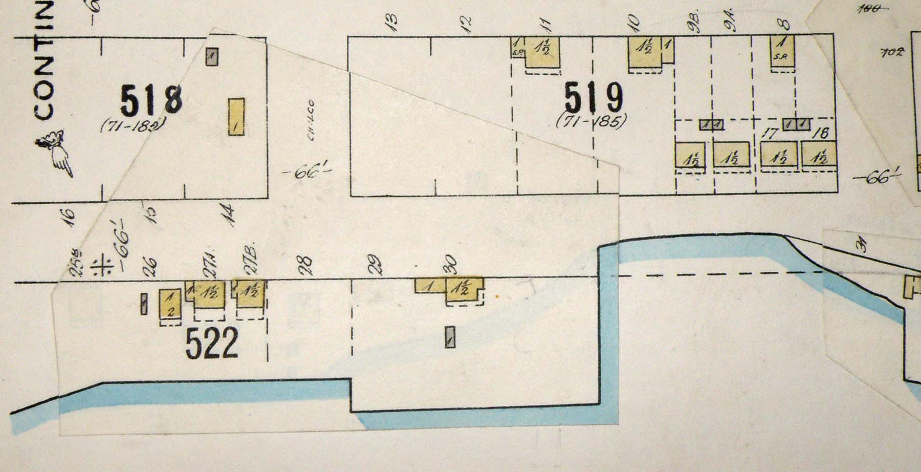 Detail from Map 384, showing buildings in the same two blocks as in the photograph.