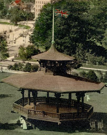Alexandra Park bandstand. It appears that these two women are moving concert equipment, probably chairs. Detail from reference code AM54-S4-: Be P93
