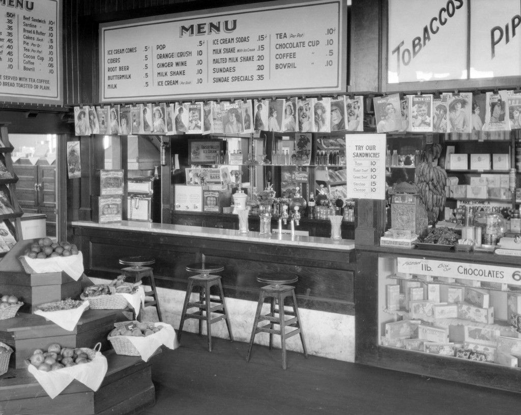B.C. Electric Railway Company News Stands- lunch counter, 1921. Stuart Thomson, photographer. Reference code: AM1535-: CVA 99-3551