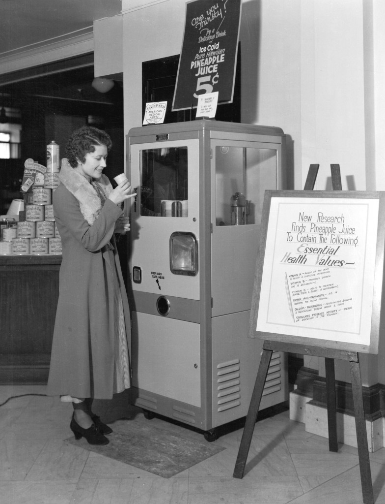Woman using pineapple juice vending machine at the Hudson's Bay store, Sept. 20, 1933. Stuart Thomson, photographer. Reference code: AM1535-: CVA 99-4559