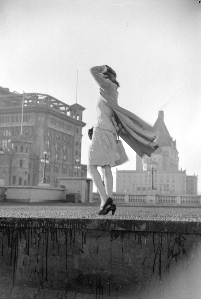 Vancouver Sun fashion editor Marie Moreau poses on the roof of the Hudson's Bay store, March 2, 1942. Reference code AM1184-S3-: CVA 1184-114. Photographer Jack Lindsay.