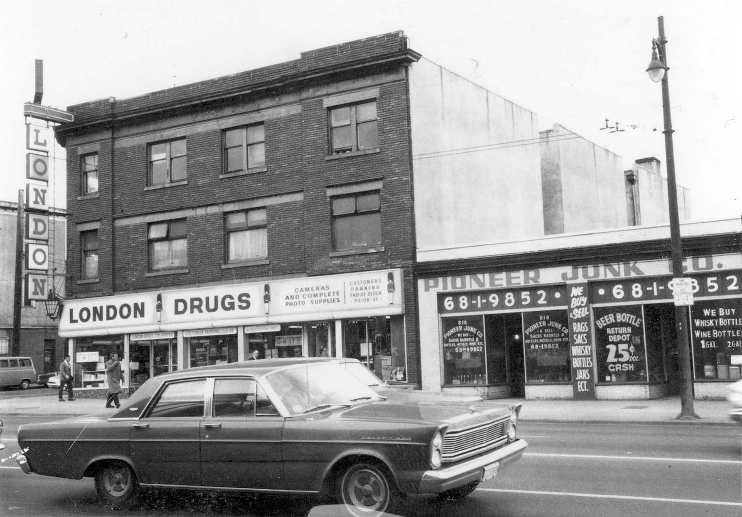 800 - 804 Main Street, 1968. Photograph shows London Drugs (800 Main Street) and Pioneer Junk Co. (818 Main Street). Reference code COV-S168-: CVA 203-10