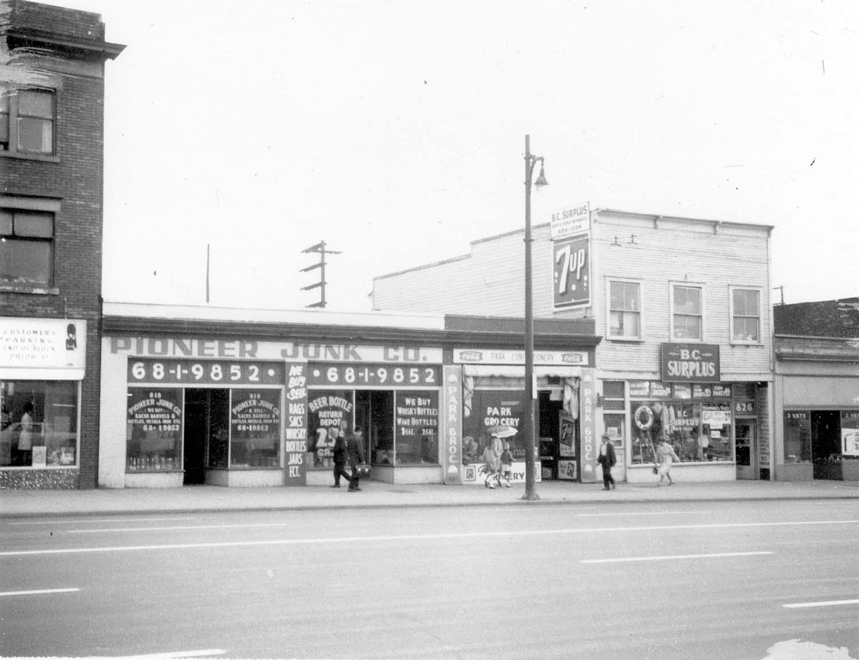 818 - 826 Main Street, 1970. Photograph shows Pioneer Junk Co. (818 Main Street), Park Grocery (822 Main Street) and BC Supplies (826 Main Street). Reference code COV-S168-: CVA 203-12