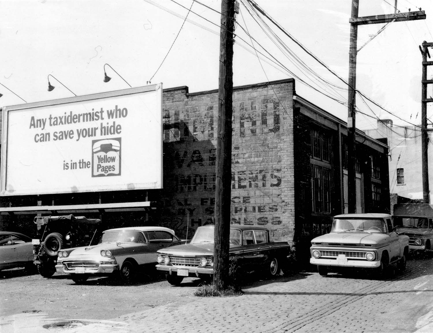 Back of 832 Main Street, 1969. Photograph shows 3 Vets War Surplus store.Reference code COV-S168-: CVA 203-19