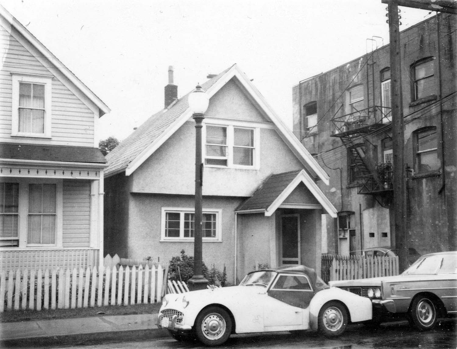 218 Union Street [front], 1969. Photograph also shows part of house at 224 Union Street and the back of the building at 800 - 822 Main Street. Reference code COV-S168-: CVA 203-36