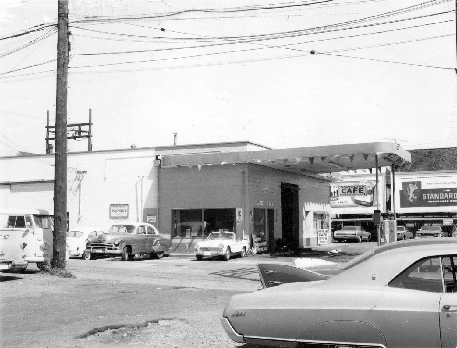 219 and 221 Prior Street, 1969. Photograph shows the Iberica Garage and the Northland Cafe. Reference code COV-S168-: CVA 203-59