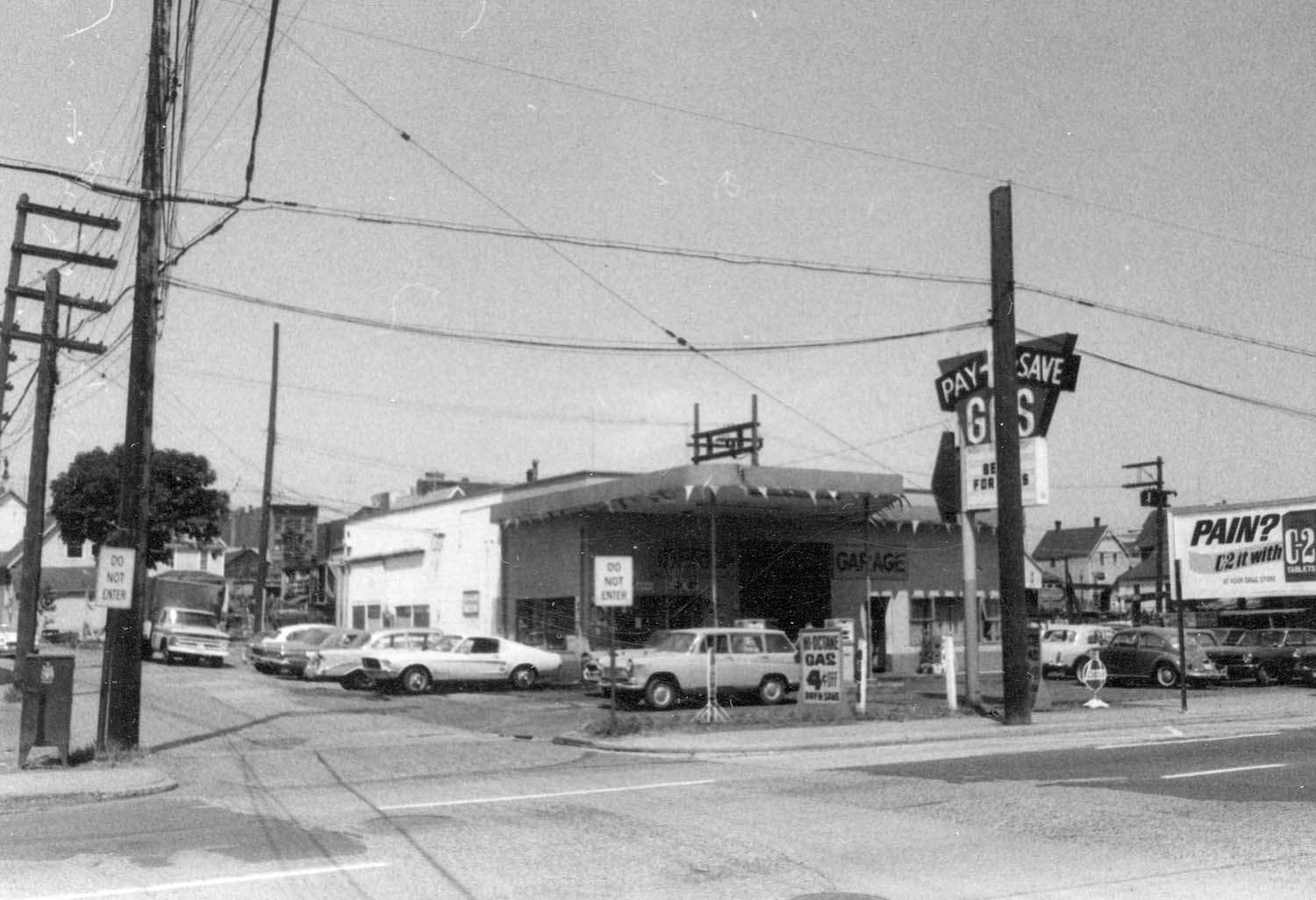 Front and west side view of subject [219 - 221 Prior Street] at lane, 1969. Photograph shows Iberica Garage and Northland Cafe. Reference code COV-S168-: CVA 203-53