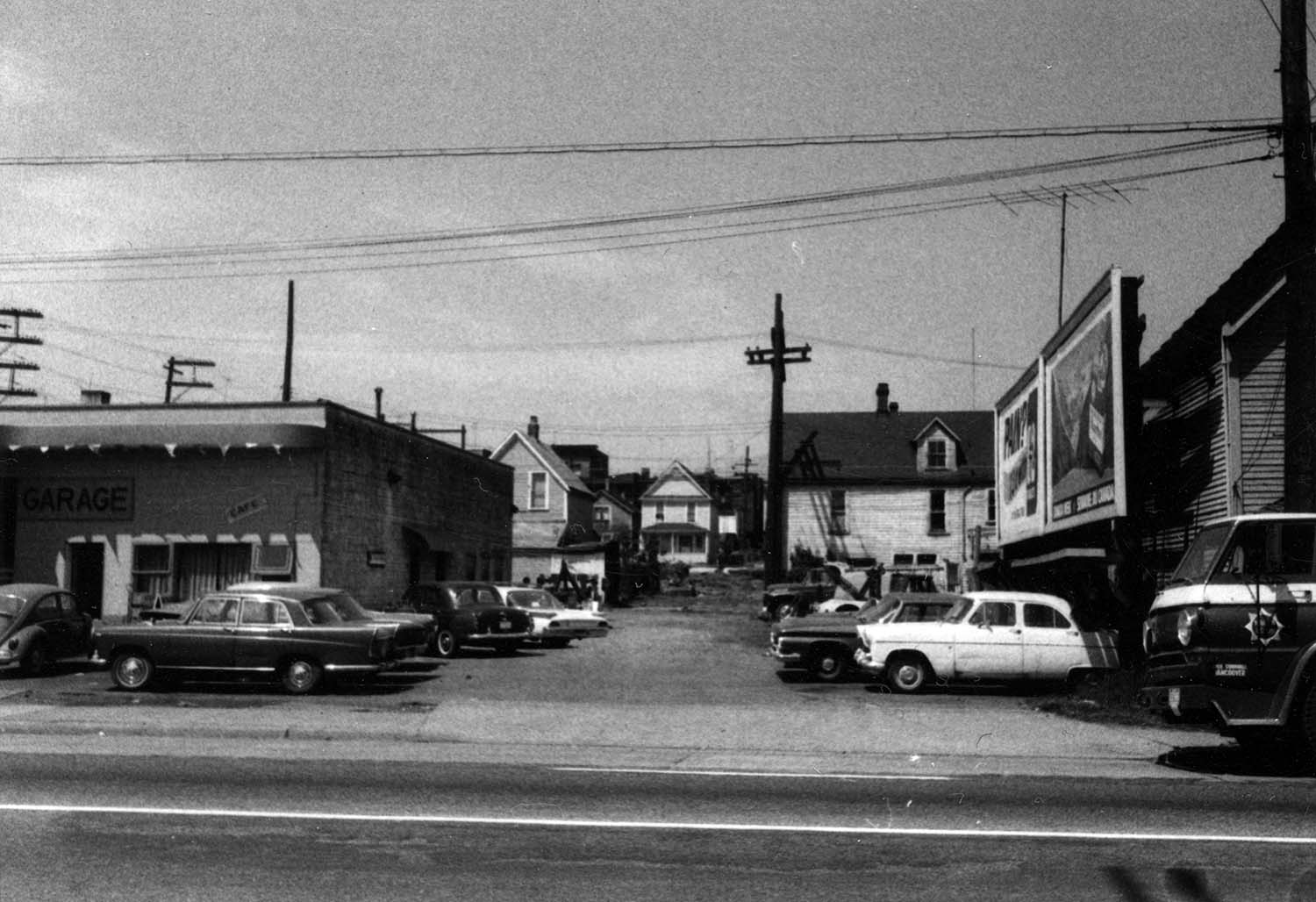 Parking on vacant land and billboard at east side [of Iberica Garage and Northland Cafe 219 - 221 Prior Street], 1969. Reference code COV-S168-: CVA 203-56