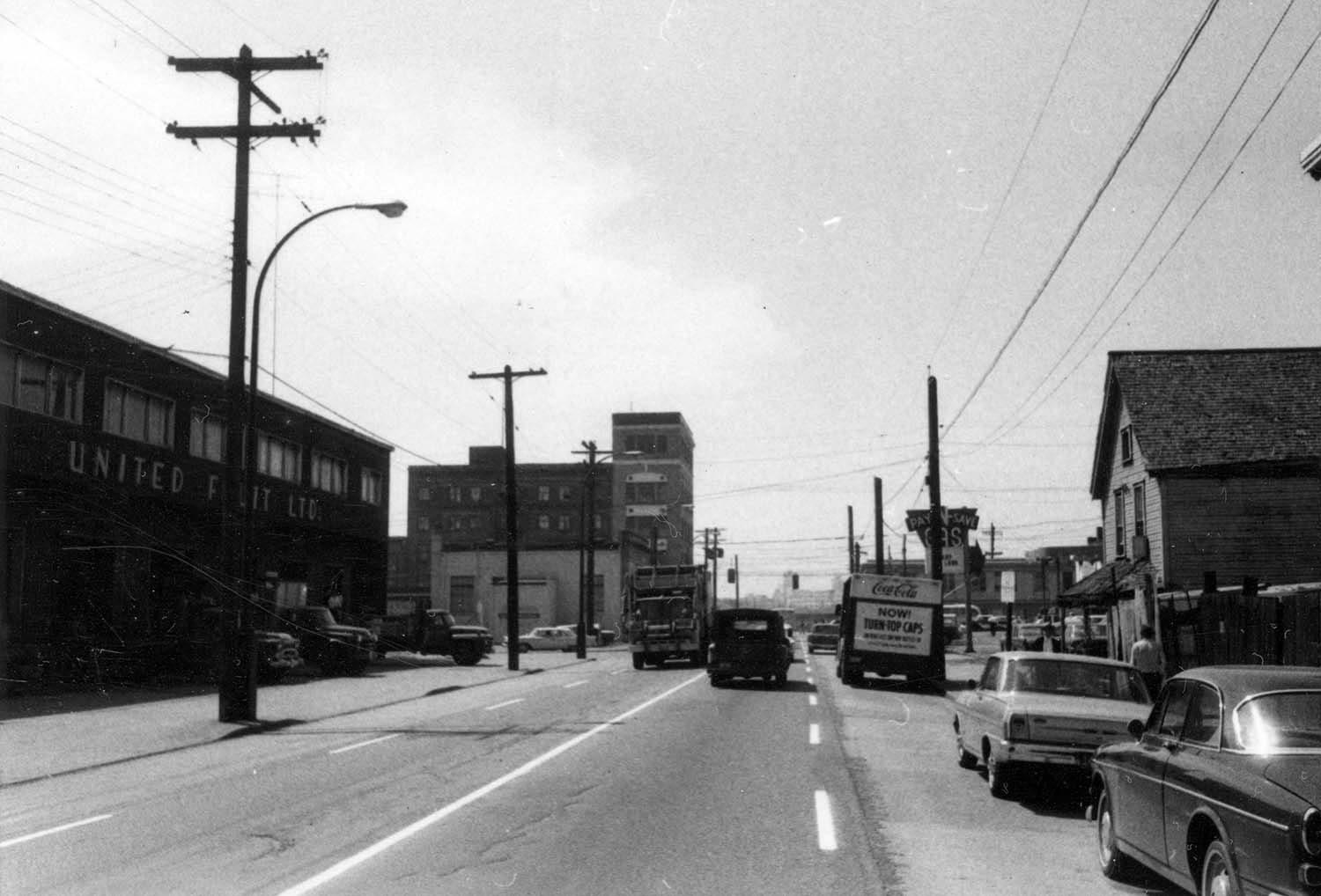 Aspect looking west along Prior Street with subject property [Iberica Garage and Northland Cafe 219 - 221 Prior Street] on right side, 1969. Reference code COV-S168-: CVA 203-57