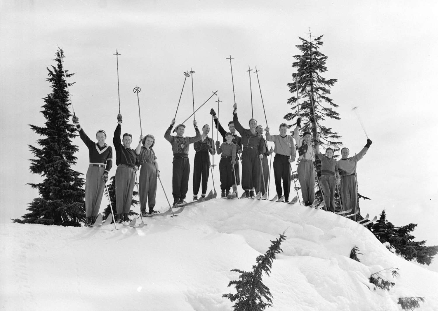 Skiers with poles in the air