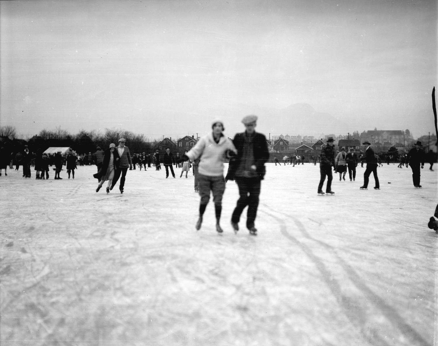 Skaters with houses in the background