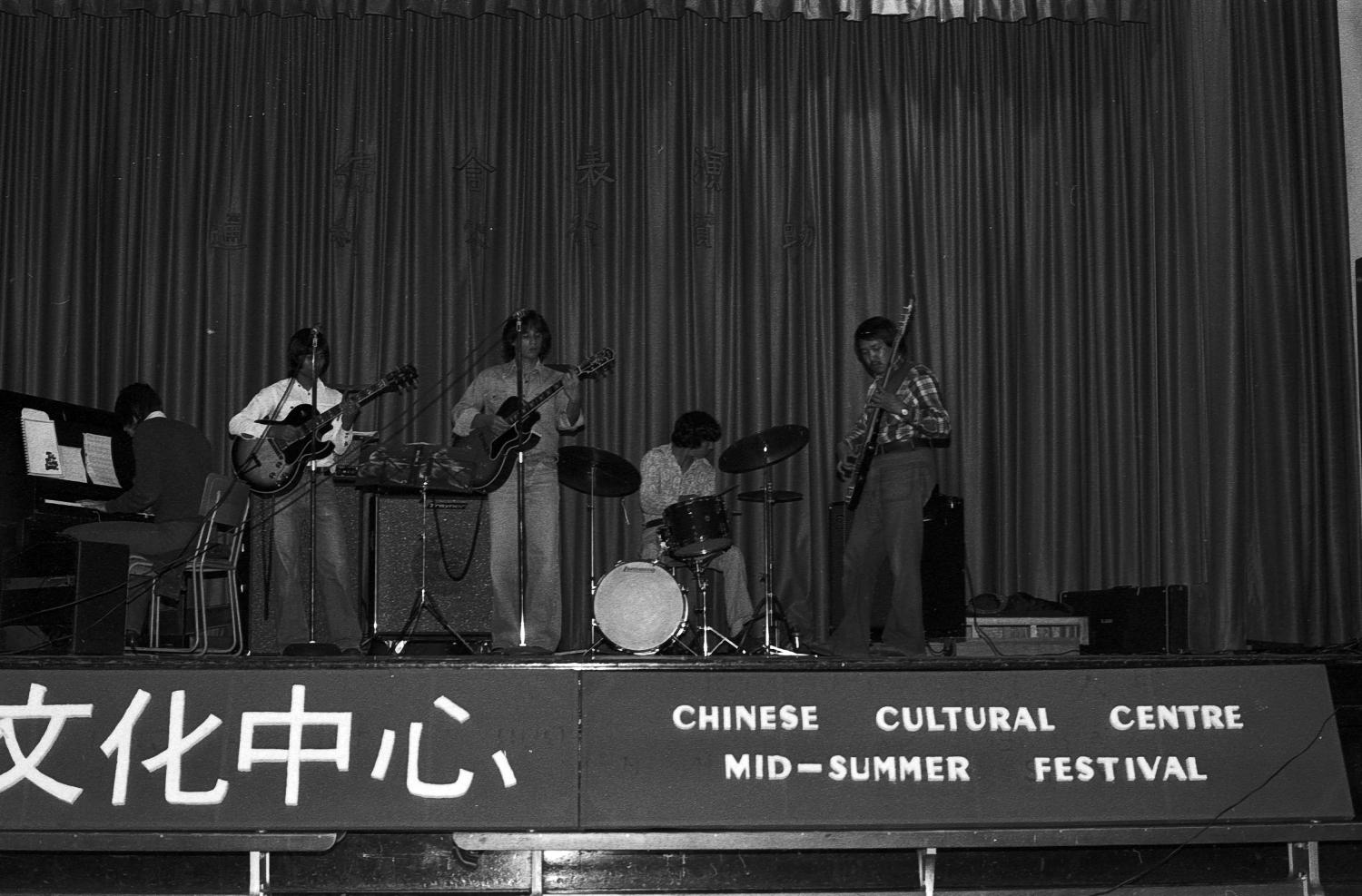 A band performing in a variety show at Strathcona Community Centre as part of the 1977 Mid-Summer Festival organized by the Chinese Cultural Centre of Vancouver. Photographer:  Paul Yee. Reference code AM1523-S6-F11-: 2008-010.0256.