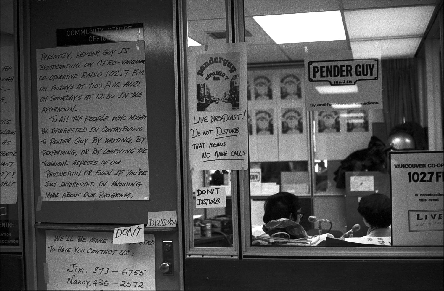 Signs outside an office at Strathcona Community Centre in which an on-air broadcast of Pender Guy was taking place, ca. 1978. Photographer:  Paul Yee. Reference code AM1523-S6-F12 -: 2008-010.0999.