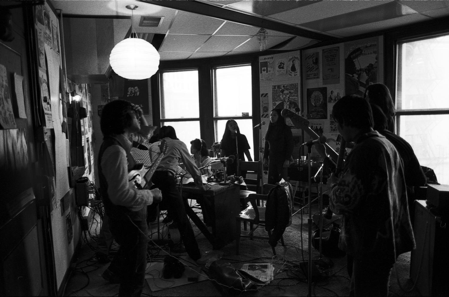 Vancouver-based activist band Kokuho Rose Prohibited performing during a marathon weekend at Vancouver Co-op Radio, May 1978. Photographer:  Paul Yee. Reference code AM1523-S6-F14-: 2008-010.1087.