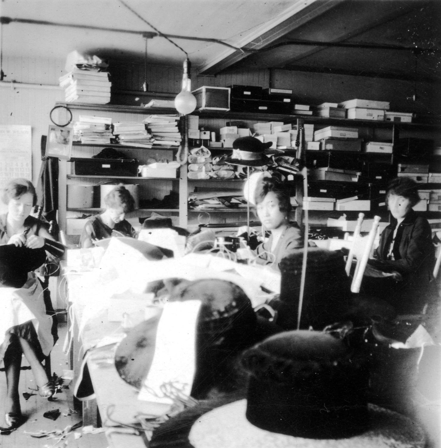 Lillian Ho Wong and her co-workers at a millinery shop, ca. 1919. One of Paul's Aunt Lillian's first places of employment was the Wonder Millinery Shop at 776 Granville Street in downtown Vancouver; this photograph may have been taken there. Reference code AM1523-S5-1-F013-: 2008-010.3056