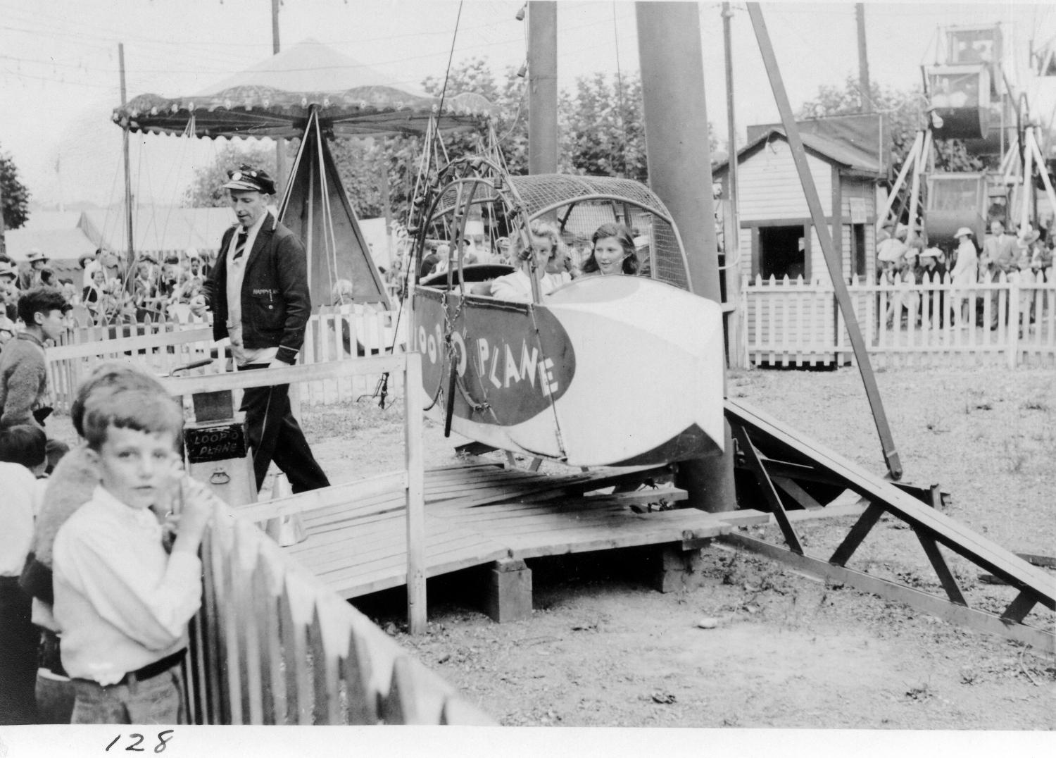 Loopo plane ride in midway carnival, 1940. Item CVA 180-0798.