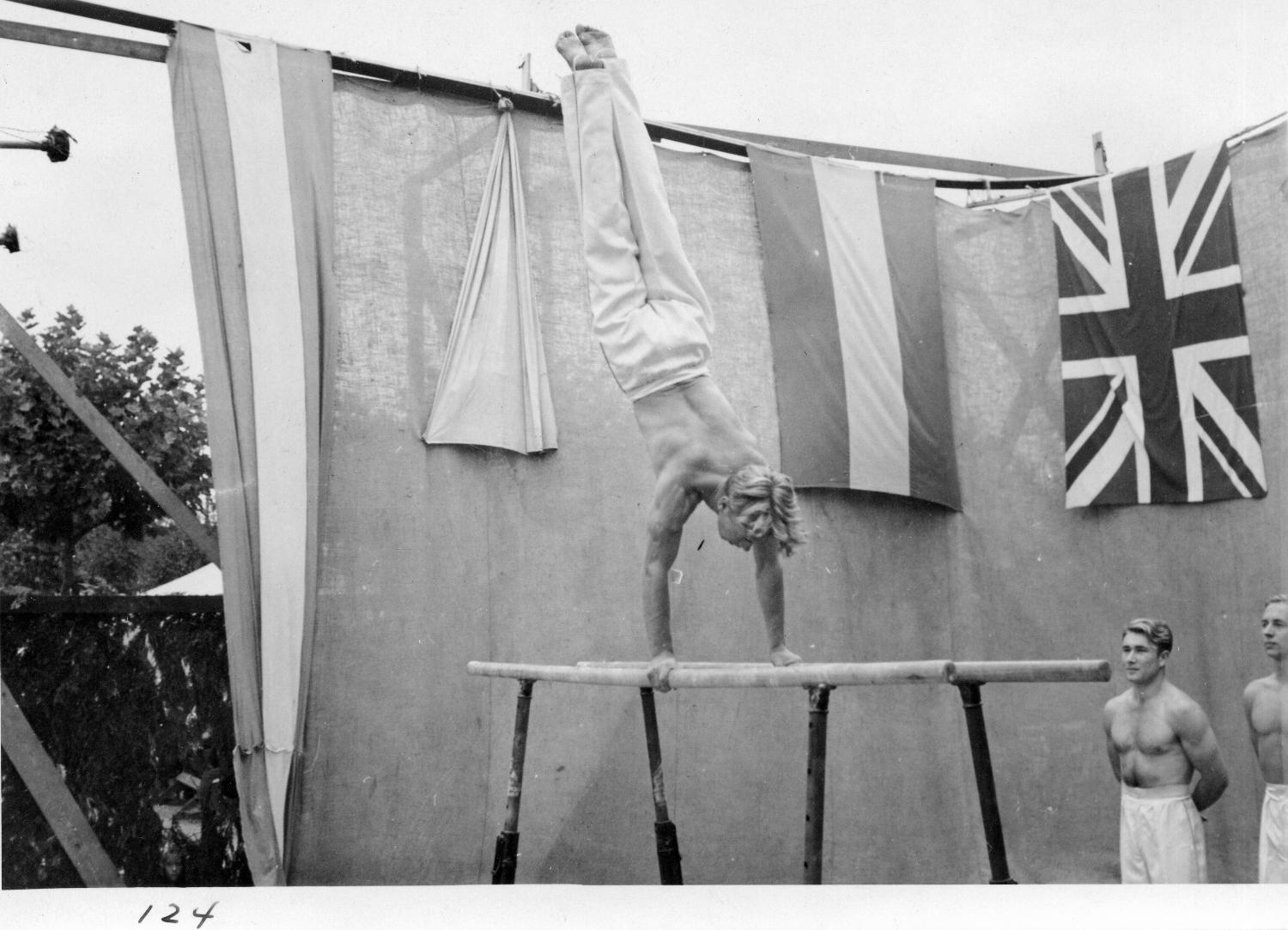 Acrobatic performance in midway carnival sideshow, 1940. Item CVA 180-0799.