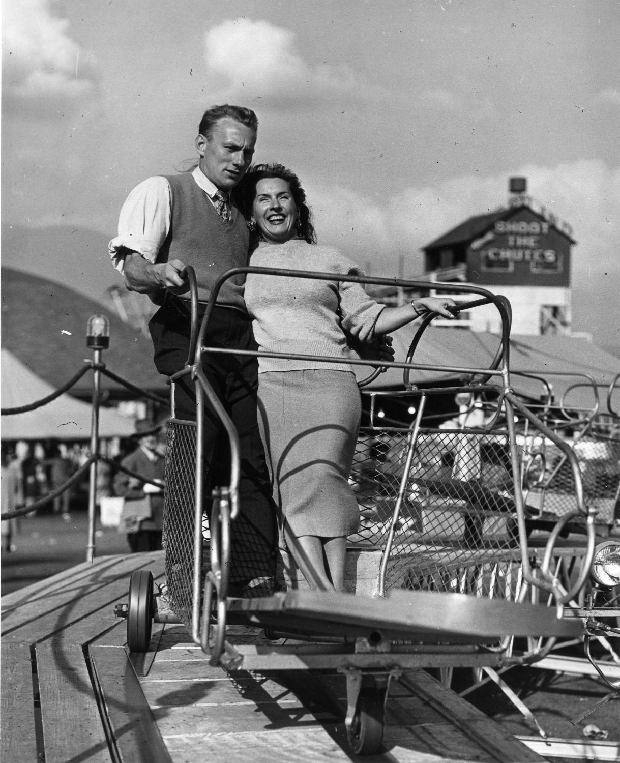 Couple on amusement park ride in P.N.E. Gayway, 1948. Item CVA 180-1520