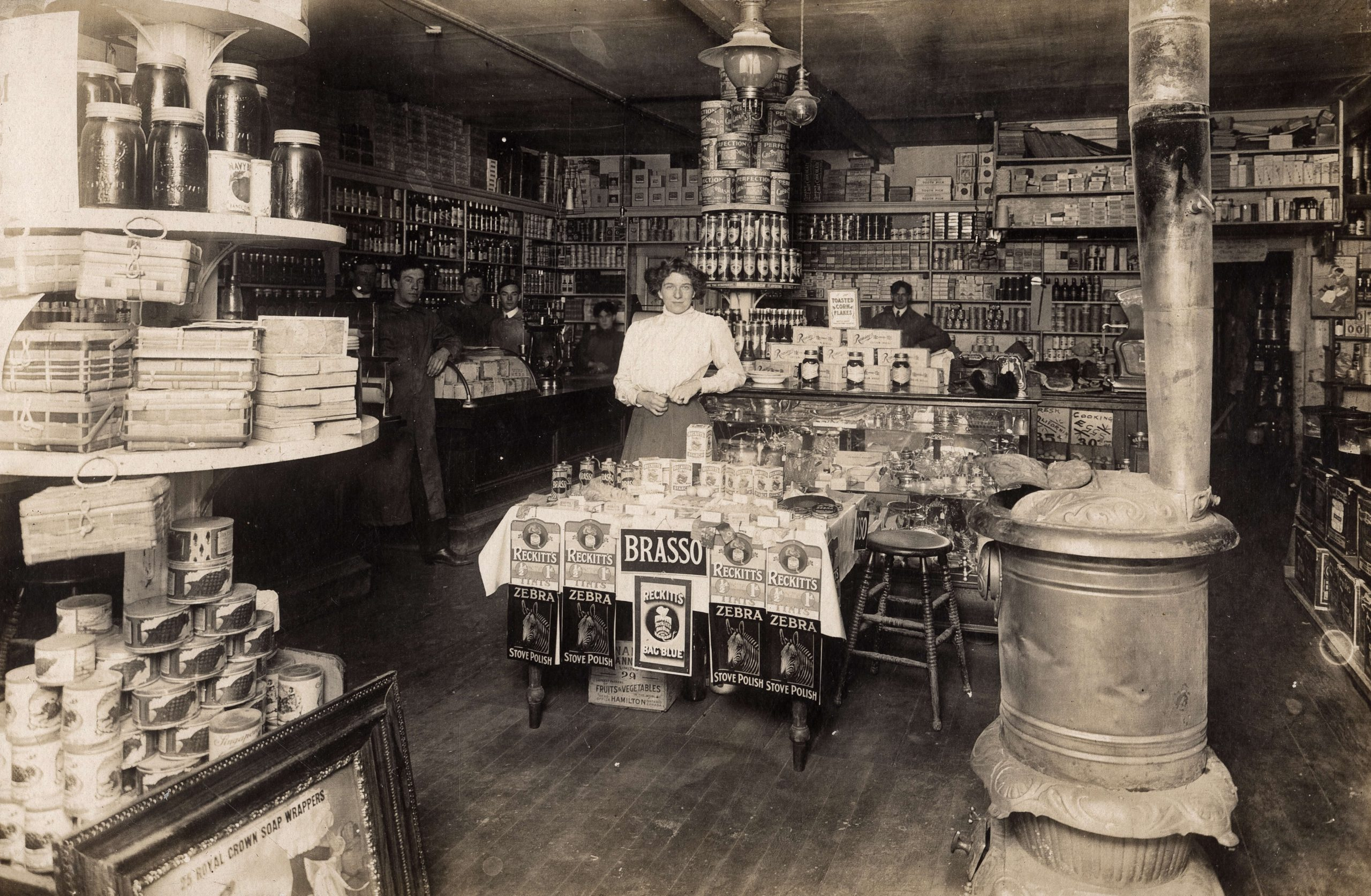 Inside the shop with tinned vegetables, corn flakes and cleaning polish. Reference code: AM1376-: 2017-028.1