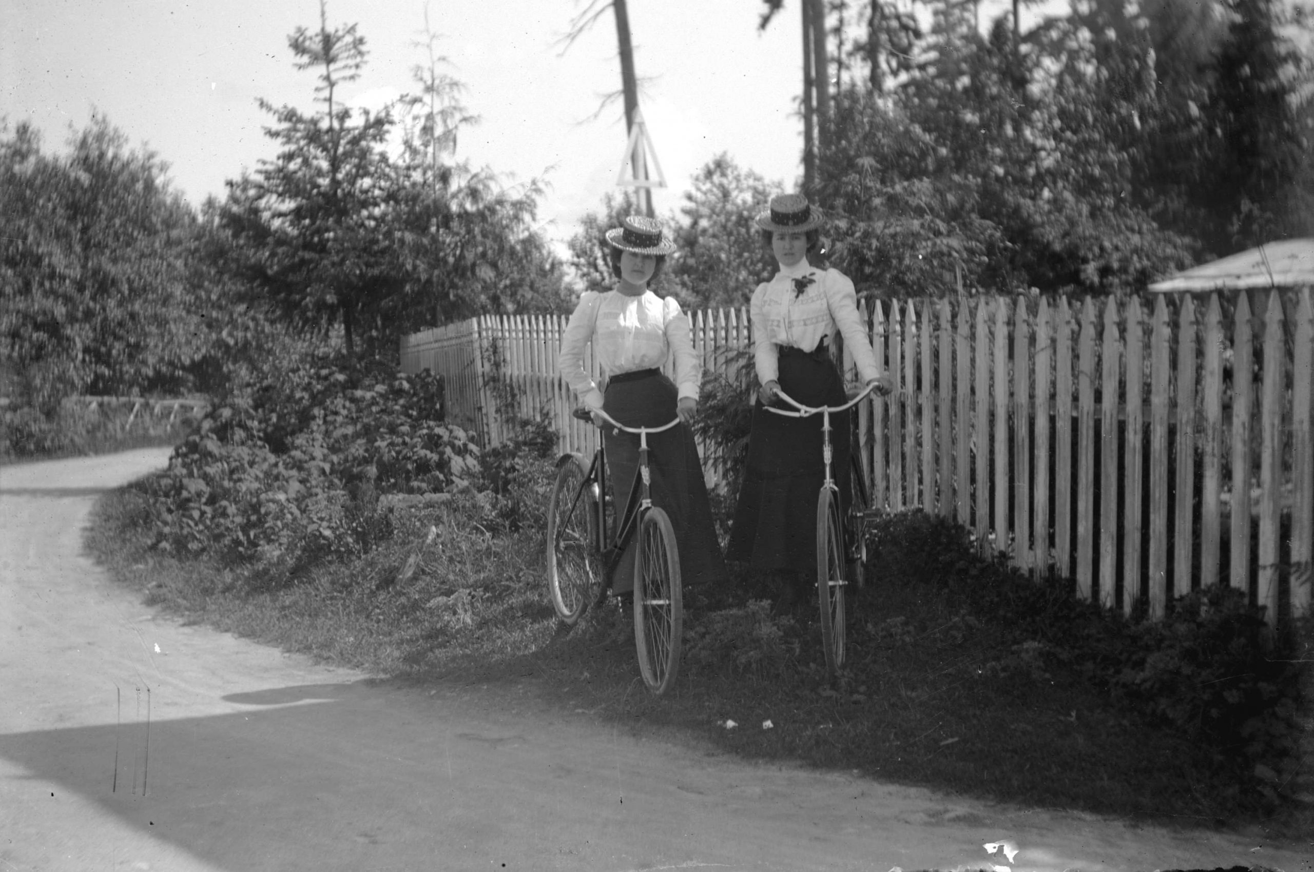 Two women standing with bicycles in Stanley Park. Reference code: AM54-S4-: SGN 119
