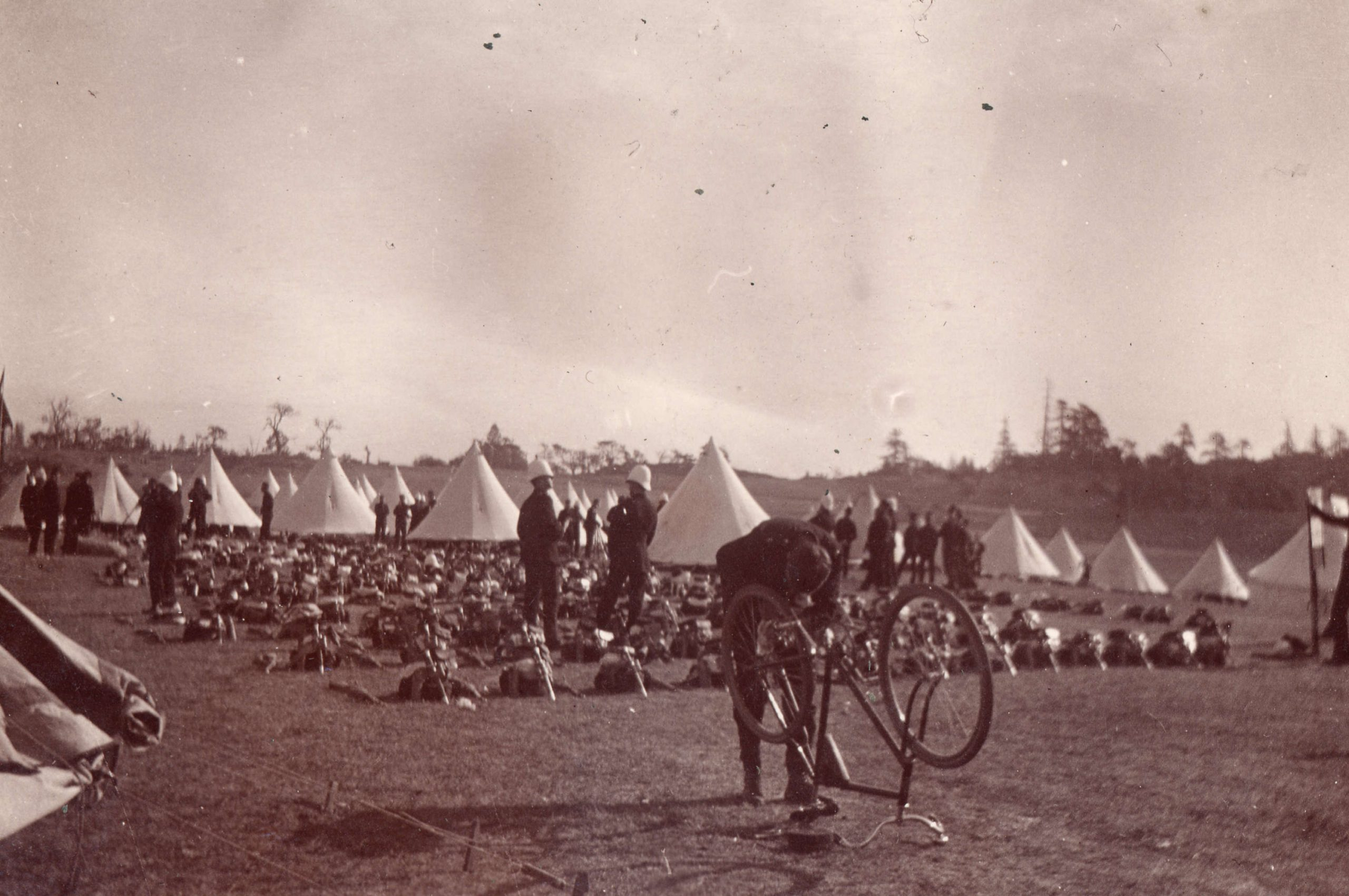 Soldier repairing bicycle. Reference code: AM54-S4-: Mil P135.3