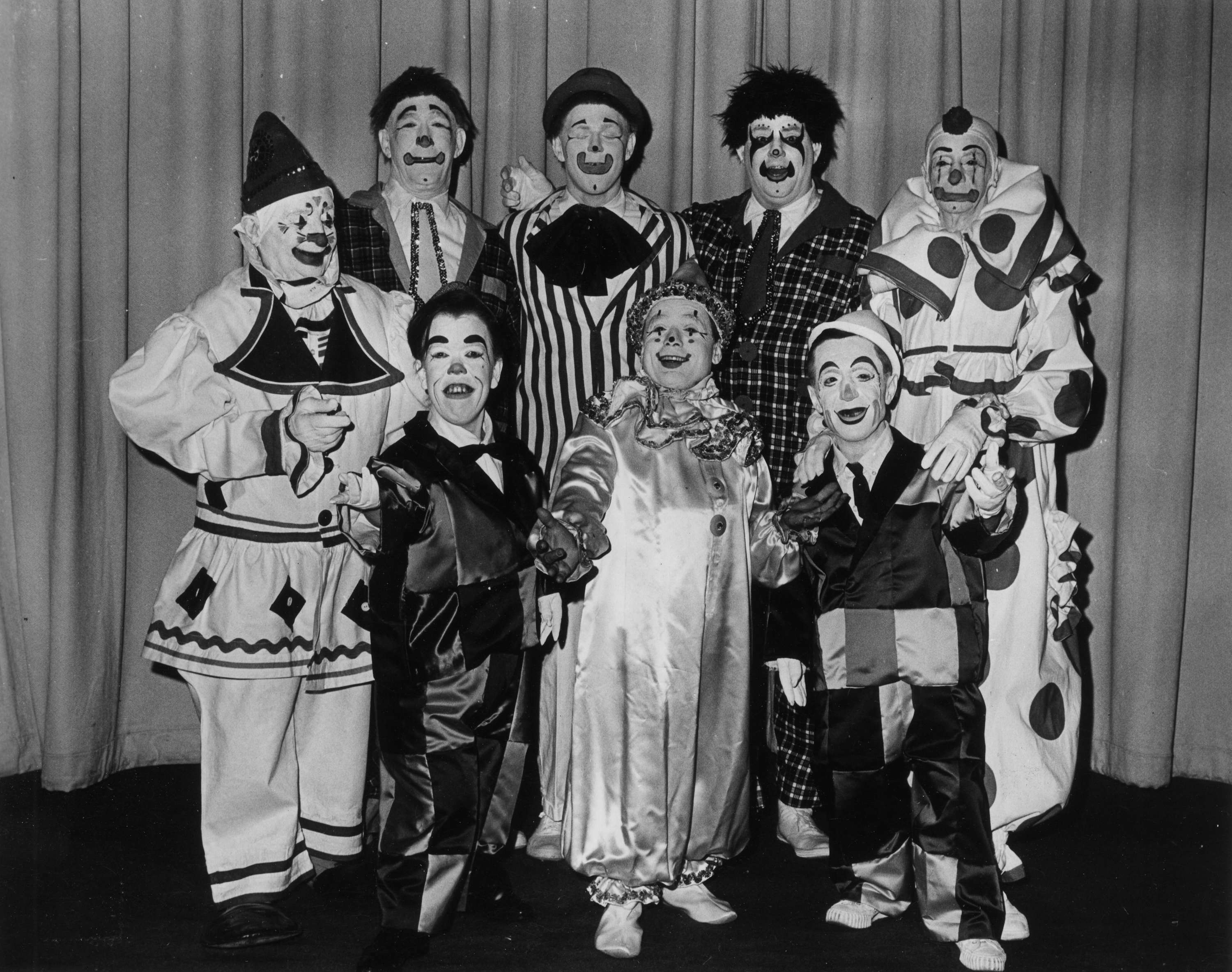 8 clowns in a group pose
