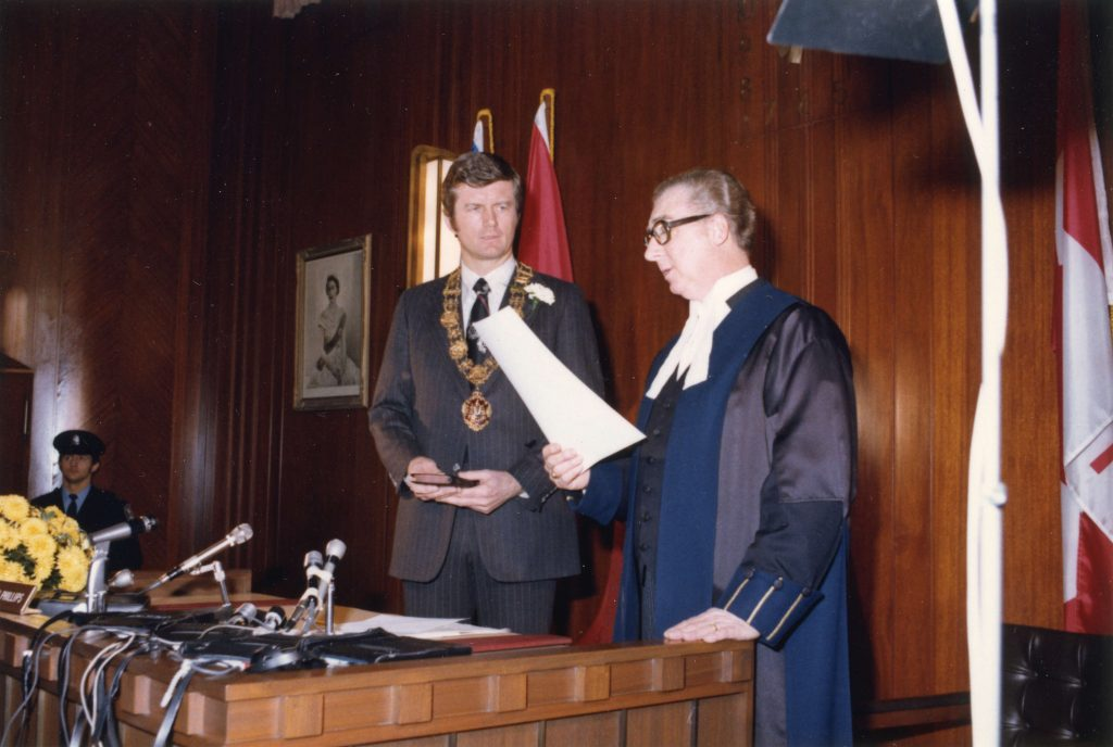 Mayor Art Phillips taking oath of office, 1975. Reference code: COV-S532-F01-: CVA 93-3
