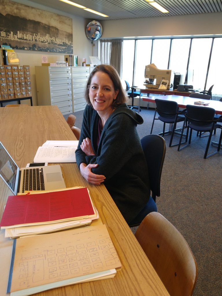 Jennifer Chutter in the Archives' Reading Room (before COVID-19 restrictions). Photo by Kira Baker.
