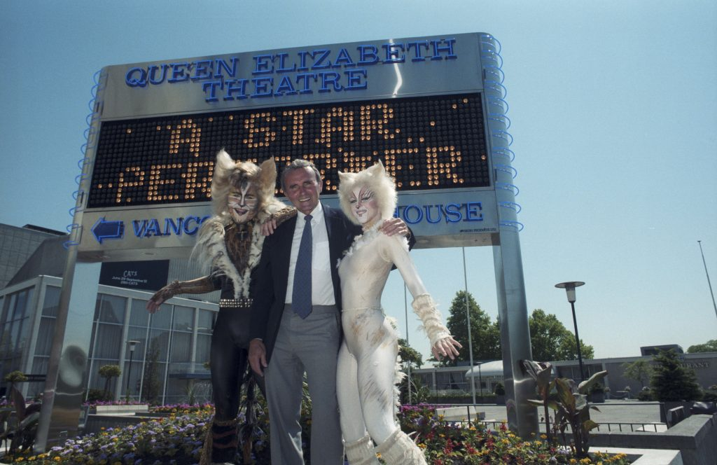 George Puil and Cats cast members in front Queen Elizabeth Theatre signboard, 1987. Reference code: COV-S477-3-F111-: CVA 775-217