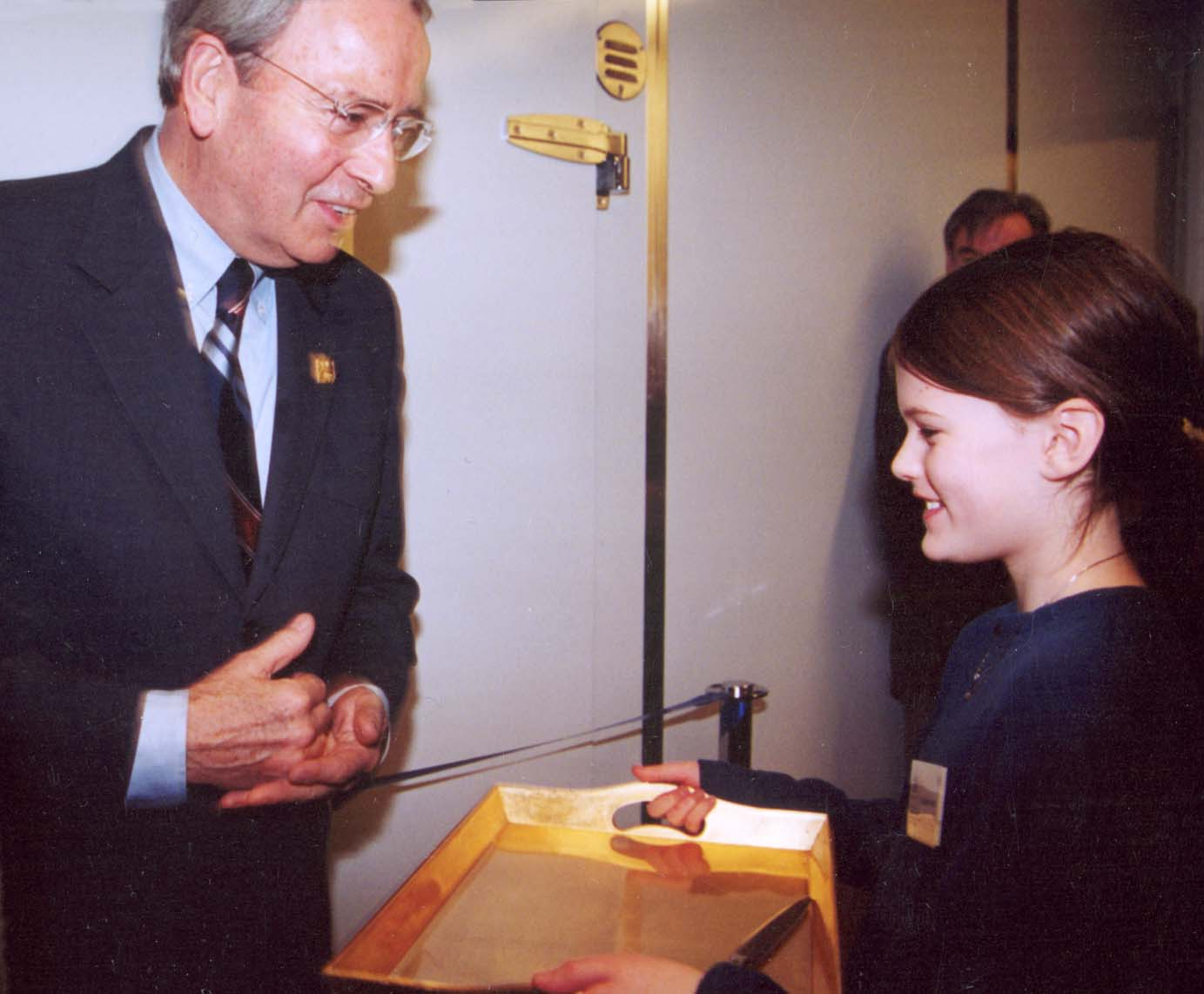 Mayor Owen being offered scissors